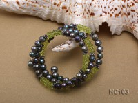 3 strand black freshwater pearl and green crystal bracelet