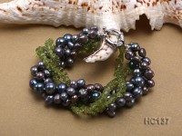 4 strand black freshwater pearl and olivine bracelet