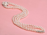 Two-strand 7-7.5mm white round freshwater pearl necklace with seashell clasp