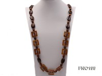 6-7mm round golden coral with brown gemstone opera necklace