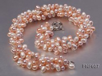 Three-strand 5×7.5mm White and Pink Cultured Freshwater Pearl Necklace.