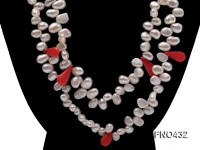 6x9mm white freshwater pearl and pink coral opera necklace
