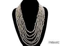 6 strand light yellow flat pearl necklace with seashell clasp