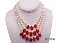 3 strand white oval freshwater pearl and red coral necklace