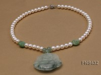 natural white round freshwater pearl necklace with buddha-shaped emerald pendant
