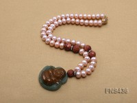 Natural lavender flat freshwater pearl necklace with buddha-shaped emerald pendant