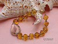 Round and Irregular Citrine Elastic Bracelet with a Gilded Ball clasp