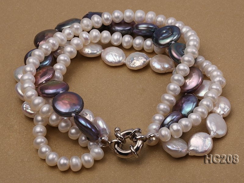 4 strand white and black freshwater pearl bracelet