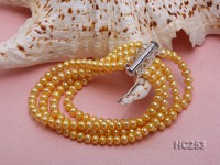 Four-row 4x5mm yellow round freshwater pearl bracelet
